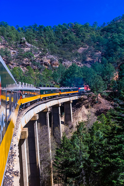 Chihuahua al Pacifico (Chepe) railroad train en route from Bahuichivo to San Rafael passes over the La Laja Bridge, Copper Canyon, Mexico