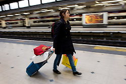 Holiday Travellers Train. Passengers run to catch trains at Euston station, London. Heavy rain and strong winds of up to 80mph are expected to bring down overhead rail lines and lead to treacherous driving conditions on what will be a busy day ahead of the holiday.Euston Station, London, United Kingdom. Monday, 23rd December 2013. Picture by Peter Kollanyi / i-Images