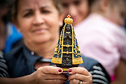A Woman holding lady of aparecida during Pope Francis General Audience in St. Peter's Square, at the Vatican, May 9, 2018.