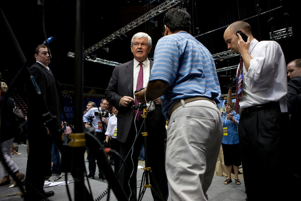 Republican presidential hopeful Newt GIngrich prepares for a television interview following the Republican presidential debate on Thursday, August 11, 2011 in Ames, IA.