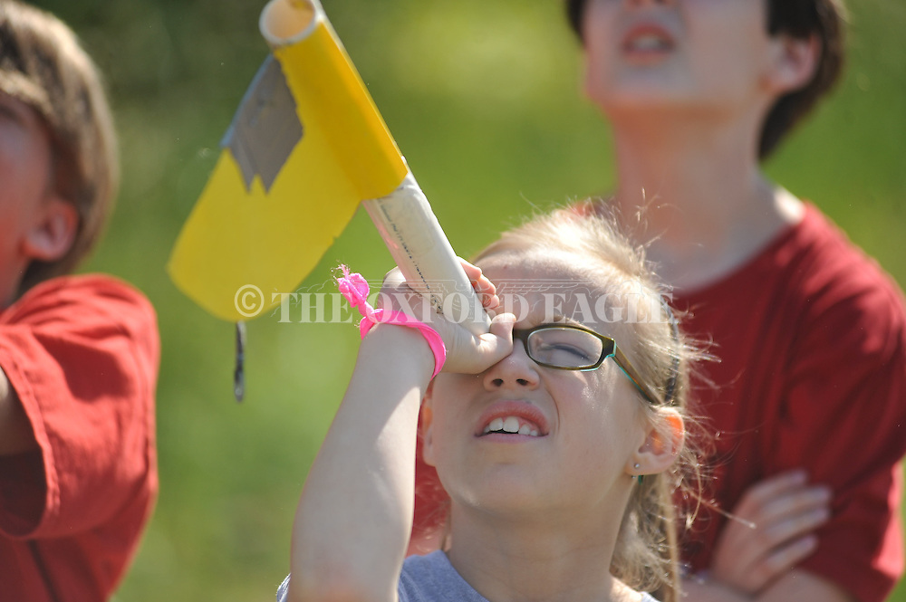 Ansley McDaniel measures the height of a rocket launch at Della Davidson Elementary in Oxford, Miss. on Wednesday, May 8, 2013.
