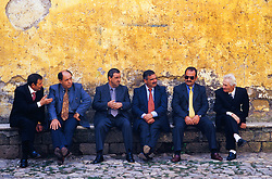 Europe, Italy, Alcalca, men in suits sitting on bench