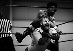 Michael Frehley is choked on the ropes by Zuka King as the referee is distracted by King's doubles partner during Old School Championship Wrestling Sunday, March 13, 2016 at the Hanahan Sports Complex. Paul Zoeller/Staff