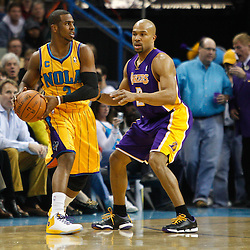 February 5, 2011; New Orleans, LA, USA; New Orleans Hornets point guard Chris Paul (3) is guarded by Los Angeles Lakers point guard Derek Fisher (2)during the first quarter at the New Orleans Arena.   Mandatory Credit: Derick E. Hingle