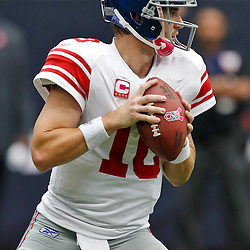 October 10, 2010; Houston, TX USA; New York Giants quarterback Eli Manning (10) against the Houston Texans during the first half at Reliant Stadium. Mandatory Credit: Derick E. Hingle