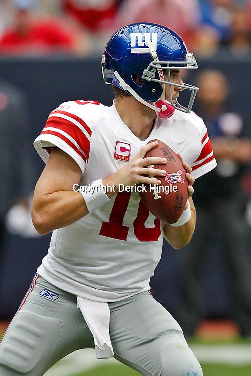 October 10, 2010; Houston, TX USA; New York Giants quarterback Eli Manning (10) against the Houston Texans during the first half at Reliant Stadium. Mandatory Credit: Derick E. Hingle