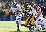 October 31, 2009: Indiana wide receiver Tandon Doss tries to pull away from the Iowa defenders during the second half of the Iowa Hawkeyes' 42-24 win over the Indiana Hoosiers at Kinnick Stadium in Iowa City, Iowa on October 31, 2009.