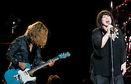 Nancy, left, and Ann Wilson of Heart perform Tuesday at the Morris Performing Arts Center in South Bend.