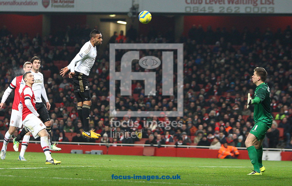 Picture by Paul Terry/Focus Images Ltd +44 7545 642257.16/01/2013.Wojciech Szczesny of Arsenal tips the shot of Kyle Bartley ( C ) of Swansea City onto the bar during the The FA Cup match at the Emirates Stadium, London.