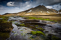 Kerlingarfjöll Mountain Range, Interior of Iceland. Green moss in foreground, Mount Fannborg in background.