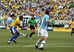 JUNE 09 2012:   Lionel Messi (10) of Argentina beats Juan (14) of Brazil to score his third goal on this shot during an international friendly match at Metlife Stadium in East Rutherford,New Jersey. Argentina won 4-3.