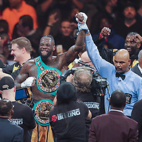 Deontay Wilder celebrates after knocking out Luis Ortiz during the WBC Heavyweight Championship boxing match at Barclays Center on Saturday, March 3, 2018 in Brooklyn, New York. Wilder would win the bout by knockout in the tenth round to retain the title and move to 40-0. (Alex Menendez via AP)
