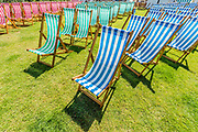 Deckchairs ready at one of the bandstands - Preparations for the Hampton Court Flower Show, organised by teh Royal Horticultural Society (RHS). In the grounds of the Hampton Court Palace, London.