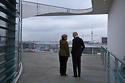 Vice President Joe Biden and German Chancellor Angela Merkel look out over Berlin skyline while talking on the balcony outside the Chancellor's office in Berlin, Germany, Feb., 1, 2013. (Official White House Photo by David Lienemann)