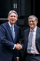 © Licensed to London News Pictures. 26/10/2016. London, UK. Business magnate and Microsoft founder BILL GATES meets Chancellor of Exchequer PHILIP HAMMOND outside Number 11 in Downing Street, London on Wednesday, 26 October 2016. Photo credit: Tolga Akmen/LNP