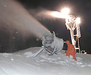 Boyne Highlands Resort night crew employee Dave Sheriff checks one of the resorts snow guns that run 24 hours a day to get ready for the upcoming ski season.