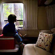Looking out the Airstream window otherwise known as camping entertainment. Apgar Campground Glacier National Park.