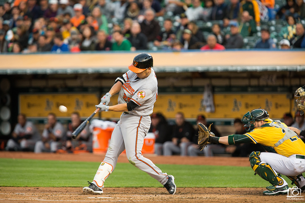 Baltimore Orioles left fielder Hyun Soo Kim (25) makes contact with a ball pitched by Oakland Athletics starting pitcher Kendall Graveman (49) at Oakland Coliseum in Oakland, Calif. on August 8, 2016. (Stan Olszewski/Special to S.F. Examiner)