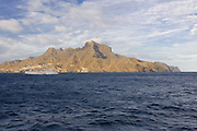 Ferry in the sea, mountains in background. San Vincente. Mindelo. Cabo Verde. Africa.