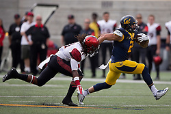 BERKELEY, CA - SEPTEMBER 12:  Running back Daniel Lasco #2 of the California Golden Bears rushes past defensive back Na'im McGee #21 of the San Diego State Aztecs during the first quarter at California Memorial Stadium on September 12, 2015 in Berkeley, California. The California Golden Bears defeated the San Diego State Aztecs 35-7. (Photo by Jason O. Watson/Getty Images) *** Local Caption *** Daniel Lasco; Na'im McGee