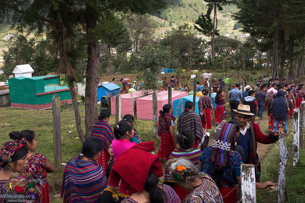 Friends and family leave the Acul cemetery after the proper burial of 36 Ixil Mayan war victims. Most of the victims, exhumed from mass graves in Xe'xuxcap, near Acul, starved in the mountainside while fleeing State-led repression in 1982. Most of the remains, exhumed by members of the Forensic Anthropology Foundation of Guatemala (FAFG) in 2013, were identified using DNA analysis and buried 35 years after their death. Acul, Nebaj, Quiché, Guatemala. February 3, 2017.
