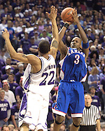 Kansas guard Russell Robinson (3) fires a shot over Kansas State's Mario Taybron (22), during the first half at Bramlage Coliseum in Manhattan, Kansas, March 4, 2006.  The Jayhawks lead at halftime 39-24.