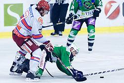 Petr Sachl (HDD Tilia Olimpija, #12) crushed by Jason Beckett (HK Acroni Jesenice, #7) during ice-hockey match between HDD Tilia Olimpija and HK Acroni Jesenice in 41st Round of EBEL league, on Januar 23, 2011 at Hala Tivoli, Ljubljana, Slovenia. (Photo By Matic Klansek Velej / Sportida.com)