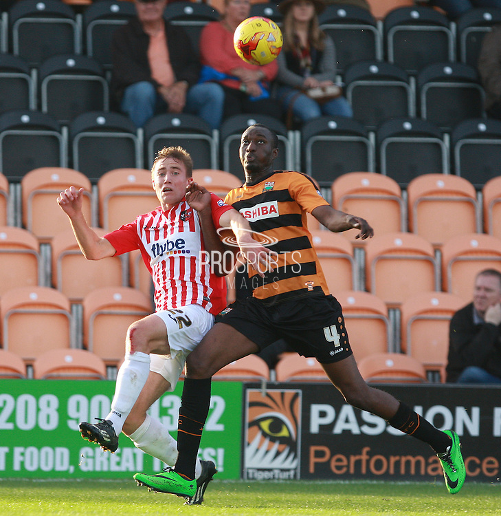 Exeter City midfielder David Wheeler and Barnet defender Bira Dembele compete for a high ball during the Sky Bet League 2 match between Barnet and Exeter City at The Hive Stadium, London, England on 31 October 2015. Photo by Bennett Dean.