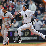 Derek Jeter, New York Yankees, runs to second base after hitting a double during the New York Yankees V Baltimore Orioles home opening day at Yankee Stadium, The Bronx, New York. 7th April 2014. Photo Tim Clayton
