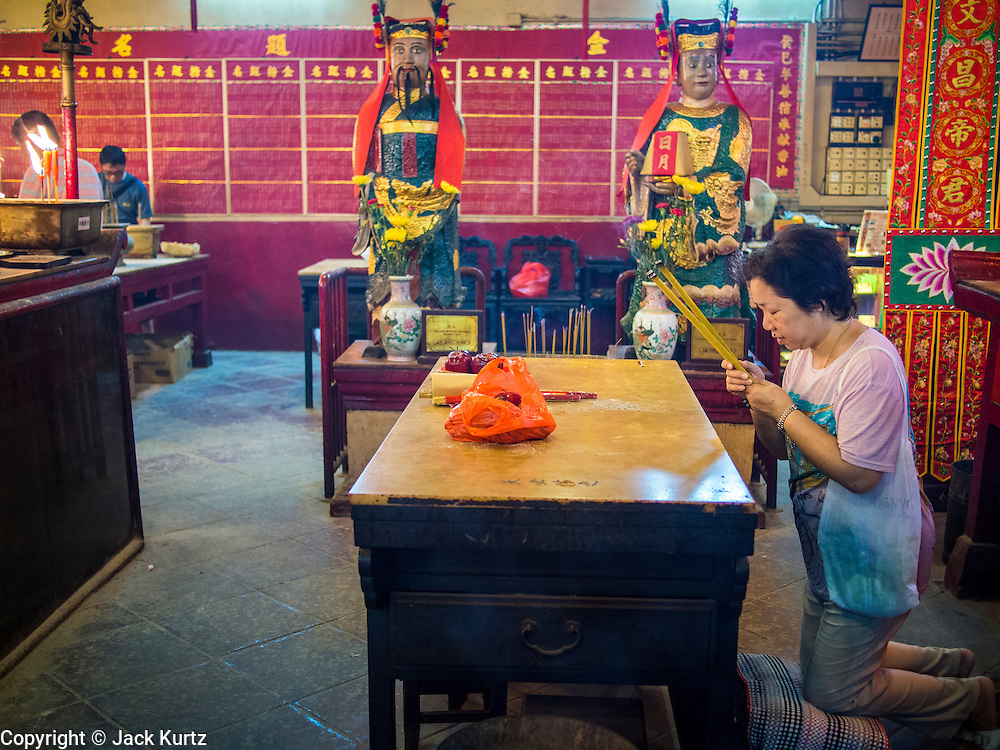 10 AUGUST 2013 - HONG KONG:  People pray in Man Mo Temple in Hong Kong. Hong Kong is one of the two Special Administrative Regions of the People's Republic of China, Macau is the other. It is situated on China's south coast and, enclosed by the Pearl River Delta and South China Sea, it is known for its skyline and deep natural harbour. Hong Kong is one of the most densely populated areas in the world, the  population is 93.6% ethnic Chinese and 6.4% from other groups. The Han Chinese majority originate mainly from the cities of Guangzhou and Taishan in the neighbouring Guangdong province.      PHOTO BY JACK KURTZ