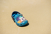 Mickey Mouse sandal on a beach in the Galapagos Islands, Ecuador.