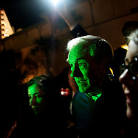 Republican Presidential candidate RON PAUL poses for pictures with supporters outside the backstage entrance to the Palisades Conference Center after holding a rally.  The South Carolina primary will be held on January 21st.