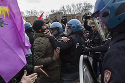 February 5, 2018 - Rome, Rome, Italy - Police with clashing with protesters..Hundred of demonstrators clashed with police near the Vatican during the Turkish president's visit to Rome, as protesters denounced Recep Tayyip Erdogans' presence amid Ankara's anti-Kurdish military campaign in Syria, at least one person injured. (Credit Image: © Danilo Campailla/SOPA via ZUMA Wire)