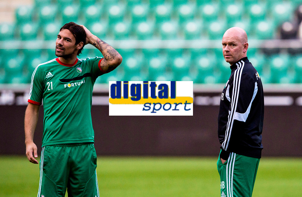 29/07/14<br /> LEGIA WARSAW TRAINING<br /> PEPSI ARENA - WARSAW<br /> Legia Warsaw captain Ivica Vrdoljak (left) joins manager Henning Berg at the Pepsi Arena for training
