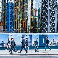 London ,UK - 18 August 2014: people walk past a construction site during the morning rush hour in The City of London