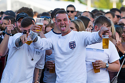 © Licensed to London News Pictures. 28/06/2018. Brighton, UK. England fans watch the the World Cup match between England and Belgium, on Brighton beach on the south coast of England. Photo credit: Hugo Michiels/LNP