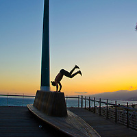 "A man does a hand stand on the public art installation entitled, ""The Beacon,""  by artist Jody Pinto amid the sunset on Wednesday, June 5, 2013. The Beacon is located at the California Incline and was dedicated on Veterans' Day 1999."