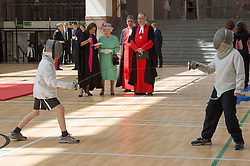 Image ©Licensed to i-Images Picture Agency. 12/06/2014. London, United Kingdom. In the frame - HM The Queen watching some fencing. <br /> HM The Queen today officially opens the new Westminster School's sports Centre for Westminster School. HM watched an array of sports including judo, fencing cricket and yoga. Picture by  i-Images
