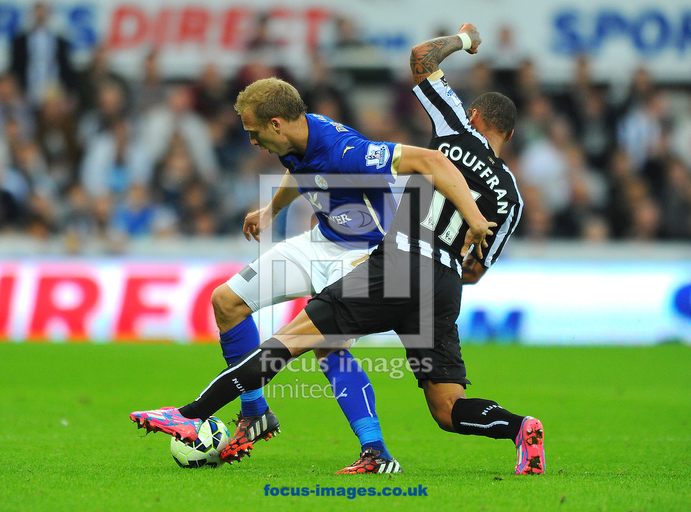 Yoan Gouffran of Newcastle United (right) tackles Ritchie De Laet of Leicester City during the Barclays Premier League match at St. James's Park, Newcastle<br /> Picture by Greg Kwasnik/Focus Images Ltd +44 7902 021456<br /> 18/10/2014