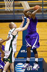December 29, 2009; Berkeley, CA, USA;  Furman Paladins forward Bryson Barnes (32) grabs a rebound from Utah Valley Wolverines forward Nick Jenson (33) during the first half at the Haas Pavilion.  Furman defeated Utah Valley 77-69.
