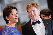 Robert Redford (R) and his wife Sibylle Szaggars attend the 'All Is Lost' Premiere during the 66th Annual Cannes Film Festival at Palais des Festivals on May 22, 2013 in Cannes, France