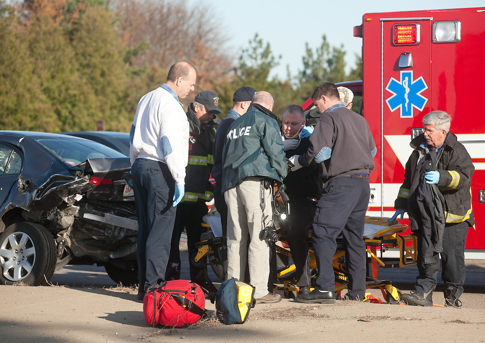 Needham, MA 03/27/2012.A Needham Police officer is transported after he was involved in a motor vehicle accident on Highland Ave. over 128 on Tuesday afternoon..Wicked Local Photo by Alex Jones