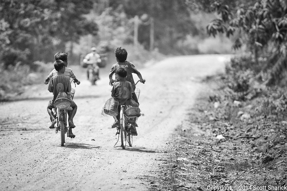 Transportation is no probelm for people in Cambodia. People of all ages ride bicycles.