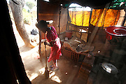 Sidonie doing the housework in the family home. <br /> <br /> Follow up visit to see Sidonie Haritiana (Patient No 074) who received surgery for her Unilateral Cleft Lip during Operation Smile&rsquo;s 2011 mission to Antananarivo when she was 7 years old. <br /> <br /> Sidonie is now 9 years old and lives with her Father Patrick, Mother Harinirima, Older Sister Chantale and younger sister Jafia. In a one room hut they rent near the brickworks which her mother and father work in. Sidonie attends school but as she is on summer holidays she helps her mother and father at work in the brick works.<br /> <br /> Outskirts of Antananarivo. Madagascar. 25th August 2014.<br /> <br /> (Operation Smile Photo - Zute Lightfoot)