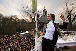 """Geraardsbergen, Belgium - Feb-24-2008 - Every year in the Flemish village of Geraardsbergen, residents gather for the spring festival """"Krakelingenfeesten"""", (Krakelingen festival) which combines a surreal combination of Pagan and Christian rituals. The towns people parade to the highest point in the village, where """"worthies"""", including a Catholic priest, drink live fish swimming in wine, from a grail served by elders dressed as Druids. The """"worthies"""" then throw biscuits to the crowd. The drinking of the live fish has become a controversial issue, with animal rights activists lobbying to have the traditional practice banned. (Photo © Jock Fistick)"""