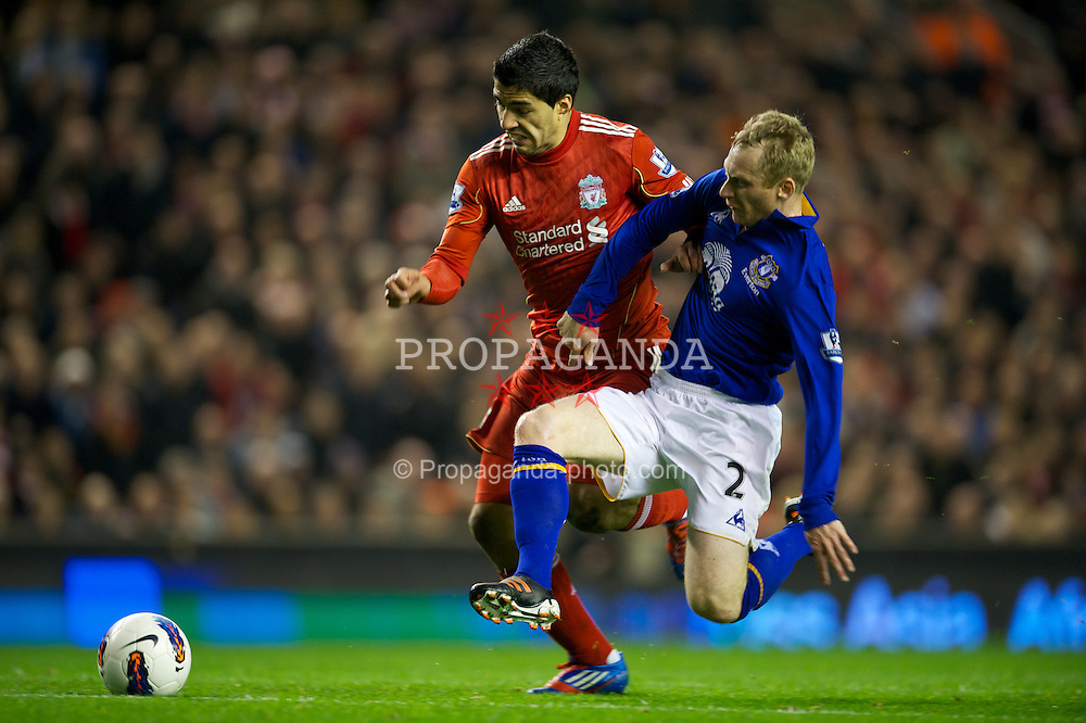 LIVERPOOL, ENGLAND - Tuesday, March 13, 2012: Liverpool's Luis Alberto Suarez Diaz in action against Everton's Tony Hibbert during the Premiership match at Anfield. (Pic by David Rawcliffe/Propaganda)