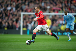 MANCHESTER, ENGLAND - Monday, April 30, 2012: Manchester United's Wayne Rooney in action against Manchester City during the Premiership match at the City of Manchester Stadium. (Pic by David Rawcliffe/Propaganda)