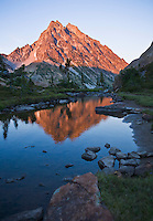 Mount Stuart reflected in still water at sunset Central Cascades Washington USA