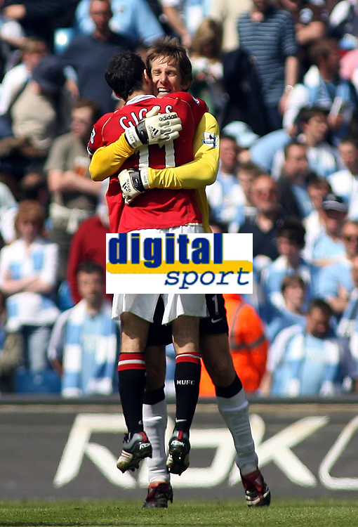 Photo: Paul Thomas.<br /> Manchester City v Manchester United. The Barclays Premiership. 05/05/2007.<br /> <br /> Keeper and hero Edwin van der Sar of Utd gets a hug from his captain Ryan Giggs (11).