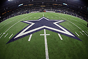 The Dallas Cowboys star logo is painted on the field turf in this general view photograph taken after the 2017 NFL week 3 preseason football game against the Oakland Raiders, Saturday, Aug. 26, 2017 in Arlington, Tex. The Cowboys won the game 24-20. (©Paul Anthony Spinelli)